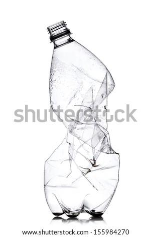 smashed empty plastic bottle, isolated on white background - stock photo