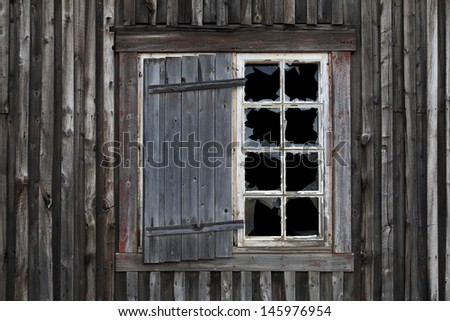 Smashed Window in Old Abandoned House - stock photo