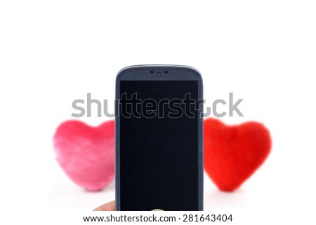 Smatrphone and hearts. Idea for lovelly message, matching, dating chat, celebrating Valentine's Day, Mother's Day, father's day, love apps, accessing apps, Internet, blogs and others. - stock photo