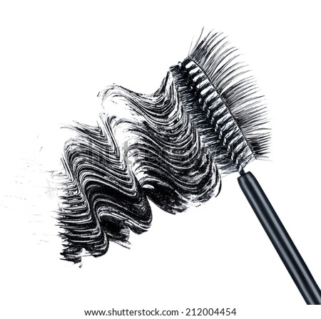 smear of black brush mascara and false eyelashes isolated on white background - stock photo