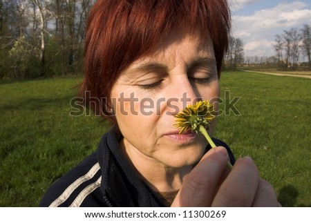 smelling dandelion - stock photo