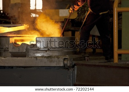 Smelting furnace with detail of a worker - stock photo