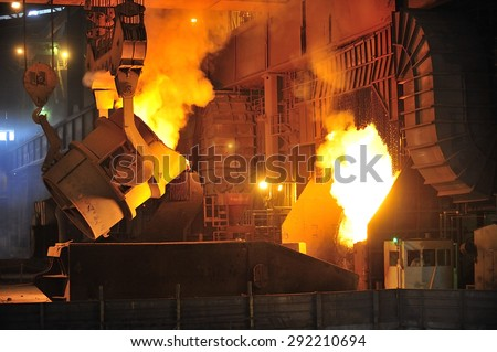 smelting of the metal in the foundry at steel mill  - stock photo