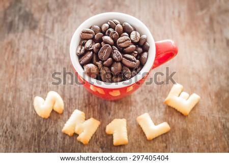 Smile alphabet biscuit with red coffee cup, stock photo - stock photo