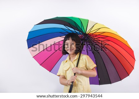 smile asia cute girl with colorful umbrella - stock photo