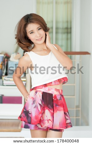 Smile beautiful asian girl on office background show fashion concept