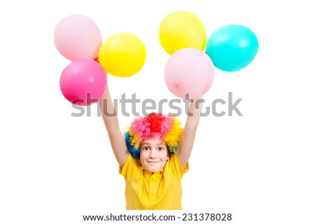 Smile boy in clown wig  hands up with  balloons, isolated on white background - stock photo
