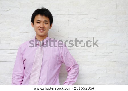 Smile business man standing on grey or background, asian - stock photo