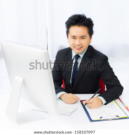smile business man working with desktop computer