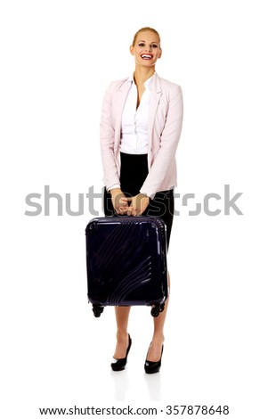 Smile business woman raising her suitcase. - stock photo