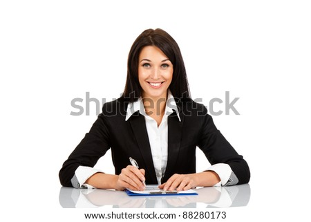 Smile business woman sitting on her desk holding a pen working with documents sign up contract isolated over white background - stock photo