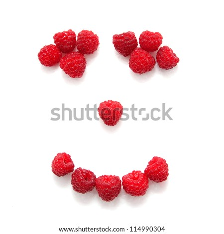 Smile composed of raspberries.  Isolated on white background - stock photo