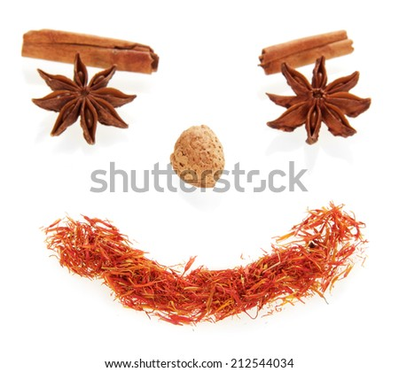 Smile face made from spices isolated on white - stock photo