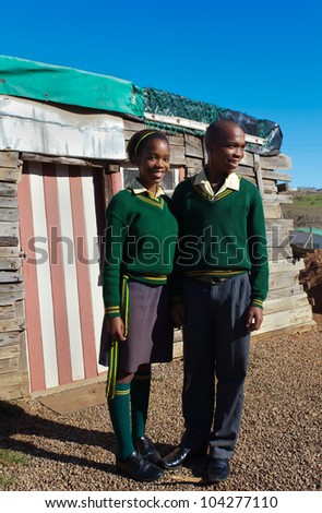 Smile for the picture in the shacks and townships./Smile/High school kids - stock photo