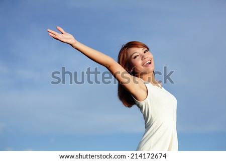 Smile Freedom and happiness carefree woman enjoying nature during travel holidays vacation outdoors. asian - stock photo