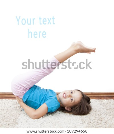 smile girl have gymnastic exercise - stock photo