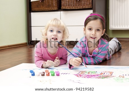 smile girl painting a color house - stock photo