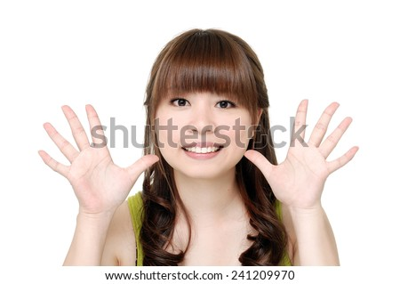 Smile girl showing something on the palm of her hand - stock photo