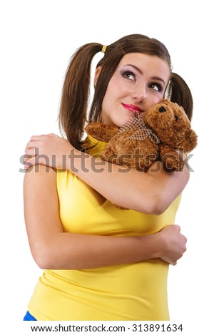 Smile girl-teenager with a teddy bear, isolated on white background. - stock photo