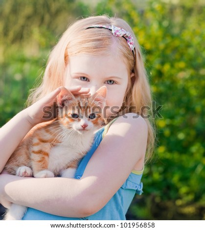 smile girl with cat outdoor - stock photo