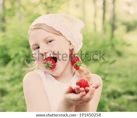 smile girl with strawberry - stock photo
