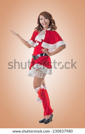 Smile happy Asian Christmas girl introduce, isolated full length portrait. - stock photo