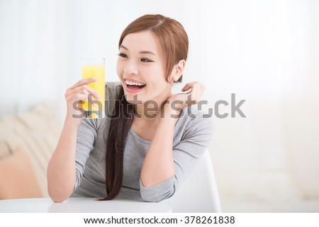 Smile happy woman hold  orange juice at home, healthy lifestyle concept, asian beauty