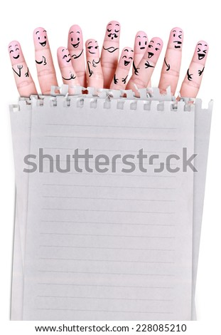 smile human by fingers for symbol of social network with blank papers - stock photo