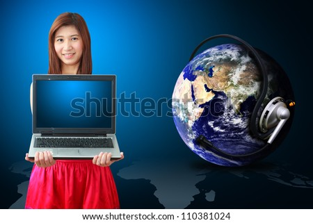Smile lady hold laptop and communication world : Elements of this image furnished by NASA - stock photo