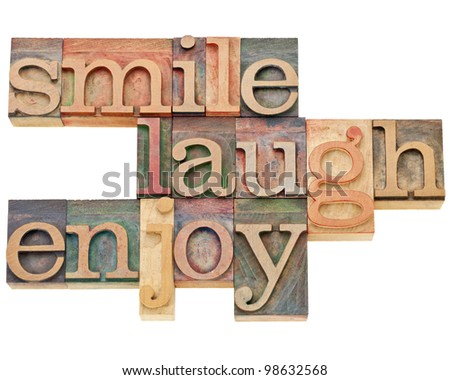 smile, laugh, enjoy - isolated text in vintage letterpress wood type