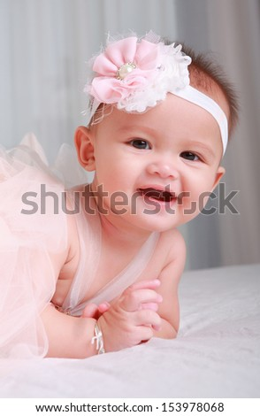 Smile Little fairy crawling on bed - stock photo