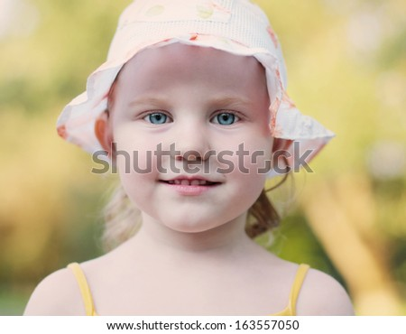 smile little girl outdoor - stock photo
