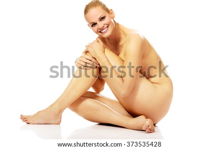 Smile nude woman sitting on the floor