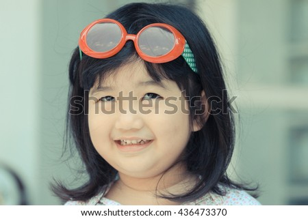 Smile of a Child,Portrait of a cute liitle girl close-up , Smile bright children ,Portrait of a beautiful liitle girl close-up  - stock photo