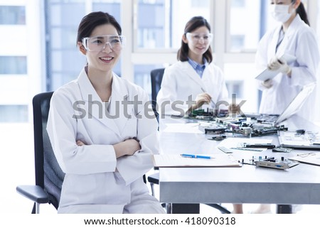 Smile of a woman wearing a white coat. - stock photo