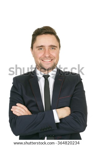 Smile of success. Half length studio portrait of a confident businessman smiling to the camera with his arms crossed