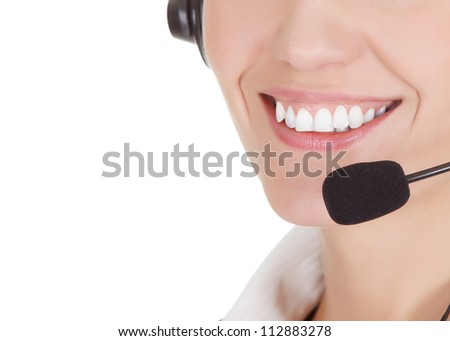 Smile of the call center operator woman - stock photo