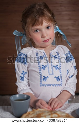smile of the girl and pancakes for Maslenitsa  - stock photo