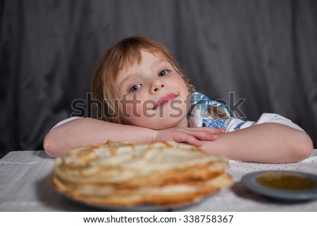 smile of the girl and pancakes for Maslenitsa