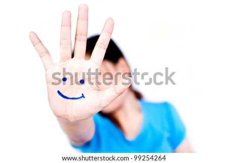 Smile on the hand for happy concept. - stock photo