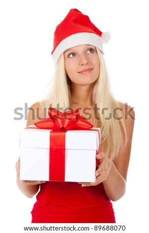 smile santa girl hold gift box, woman wear red christmas hat looking up to empty copy space, isolated over white background - stock photo