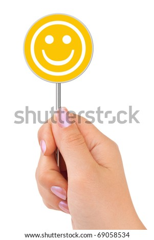 Smile sign in hand isolated on white background
