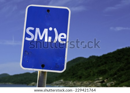 Smile sign with a beach on background - stock photo