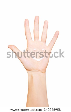 Smile symbol painted hand cream on a female palm. Isolated on white background - stock photo