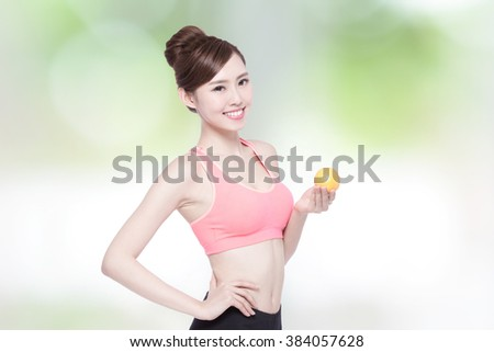 smile woman hold orange with nature green background, asian beauty - stock photo