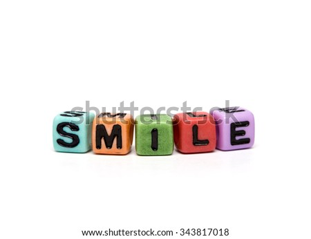 smile - word made from multicolored child toy cubes with letters - stock photo