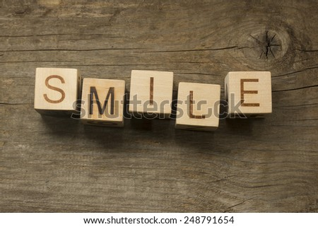 smile word on toy bricks on the table - stock photo