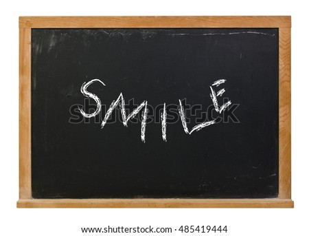Smile written in white chalk on a black chalkboard isolated on white