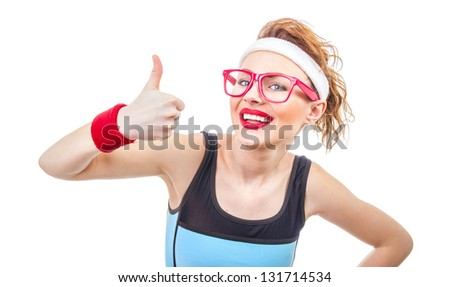Smile young fit woman gesturing thumb up, isolated on white - stock photo