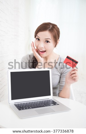 smile young woman sit and  shopping on internet at home, asian beauty